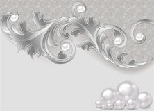 Background with a scattering of pearls and a silver ornament Royalty Free Stock Photo