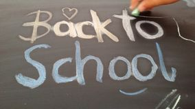 Back to school. Cute handwritten text by a child. Background for school start. Are you ready? School starts soon royalty free stock photos