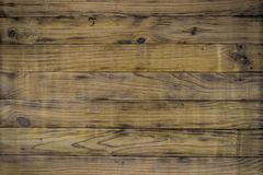 Background of scorched pine planks. Pine boards are fooled and polished Royalty Free Stock Photography