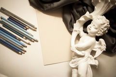 Background with sculpture and pencils Royalty Free Stock Photography