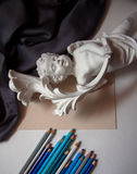 Background with sculpture and pencils Stock Image