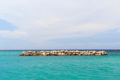 Background  sea blue sky white clouds breakwater Stock Photo