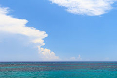 Background sea blue sky white clouds Stock Photography