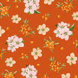 Background of sea buckthorn and flowers Stock Photo