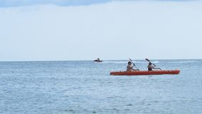 Background on the sea floating kayak for two and jet ski stock video