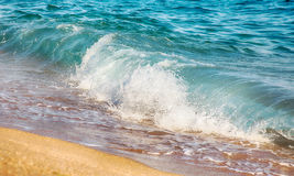 Background with sea wave on sandy beach. Royalty Free Stock Image