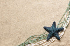 Background with seafish and beads Royalty Free Stock Photo