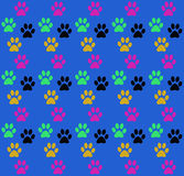 Background seamless fun print of the paws of the animal. Royalty Free Stock Photo
