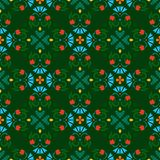 Background, seamless green pattern with red and blue flowers. Royalty Free Stock Images