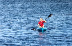 Background of Senior Woman Kayaking royalty free stock photography