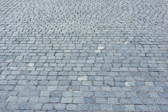 Background of sett. Cobblestone pavement. Royalty Free Stock Images