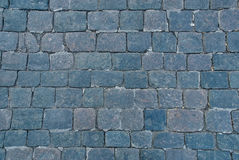 Background of sett. Cobblestone pavement. Stock Images