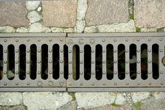 Background - sewer. Small grill with stone surface Stock Photography