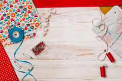 Background with sewing or knitting tools and accessories. Set for needlework placed on white wooden table. Image taken from above, top view. Copy space around Royalty Free Stock Image