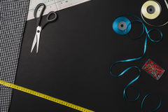 Background with sewing and knitting tools on black chalkboard Royalty Free Stock Photos