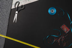 Background with sewing and knitting tools on black chalkboard Stock Photos