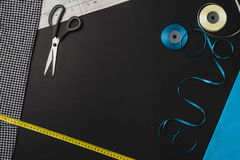 Background with sewing and knitting tools on black chalkboard Royalty Free Stock Images