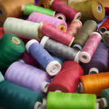 Background for sewing with spools of colorful thread royalty free stock photo