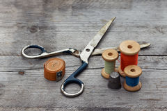 Background with sewing tools and colored  thread Royalty Free Stock Images