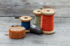 Background with  sewing tools and colored thread Royalty Free Stock Photos