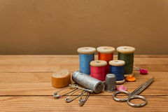 Background with sewing tools and colored thread Royalty Free Stock Image