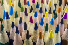 Background from sharply sharpened pencils of different colors. Sharpened pencils of different colors close-up stock image
