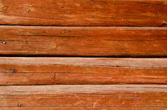 Background of shaved log wall rusty nail heads Royalty Free Stock Image