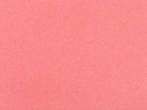 Background from sheet of coral colored pastel paper royalty free stock photo
