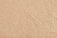 Background from sheet of crumpled kraft paper Stock Images