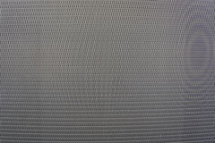 Background sheet of metal covered with abstract lines and holes Royalty Free Stock Photos