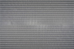 Background sheet of metal covered with abstract lines and holes Royalty Free Stock Images