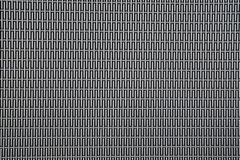 Background sheet of metal covered with abstract lines and holes Stock Image