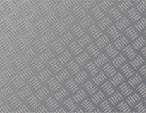 Background sheet steel or metal with a zigzag pattern. Royalty Free Stock Images