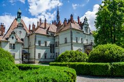 Background of Shenborn Castle in the Ukrainian Carpathian Mountains. Castle with green park in the summer season stock photo