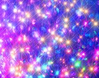 The background of shining colorful stars on blue. stock photos