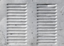 Background with shining metal ventilation grille Stock Photo