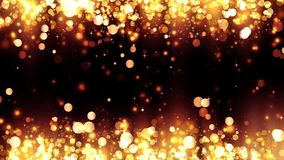 Background with shiny golden particles. Beautiful bokeh light background. Glittering gold particles. Golden confetti, magical ligh