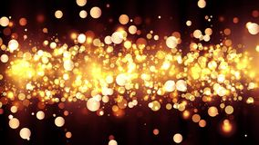 Background with shiny golden particles. Beautiful bokeh light background. Golden confetti with magical shimmering sparkling light