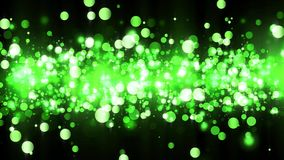 Background with shiny green particles. Beautiful bokeh light background. Green confetti shimmering with magical sparkling light. Seamless loop stock illustration