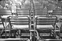 Background with shiny metal chairs Royalty Free Stock Photo