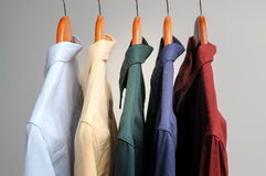 Background of shirts hanging on a hanger Stock Photos