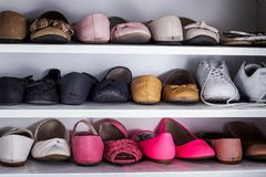 Background with shoes on shelves. In a closet Royalty Free Stock Image