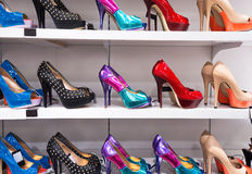 Background with shoes on shelves Royalty Free Stock Images
