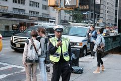 NYPD traffic officer having just picked his nose in Manhattan. stock photo