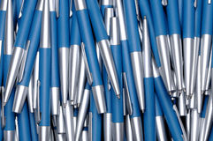 Background from silver-blue metal pens Stock Photo