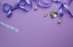 Background with silver, crystal, pearl and charms and heart moth Royalty Free Stock Photography