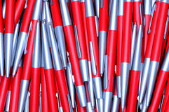 Background from silver-red metal pens Stock Photography