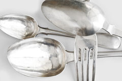 Background with silver spoons  and dinner fork Royalty Free Stock Image