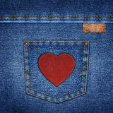 Background simple denim with leather label and red leather heart Stock Images