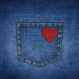 Background simple denim with pocket and red leather heart Royalty Free Stock Photos